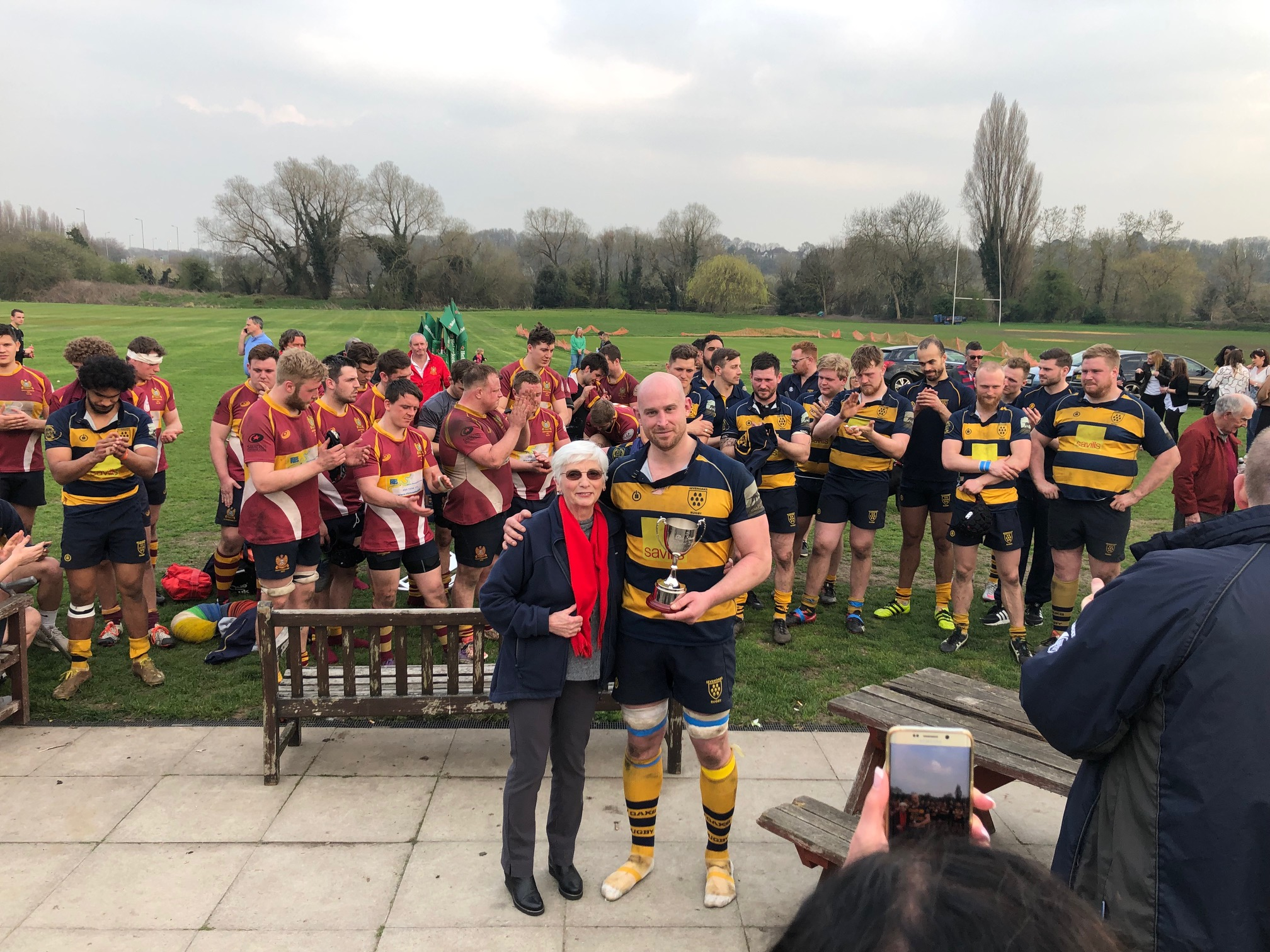 Oaks captain Stuart Coleman receives the Ron Standen Cup from Pat Standen. Photo Credit: Steve Fitzmaurice