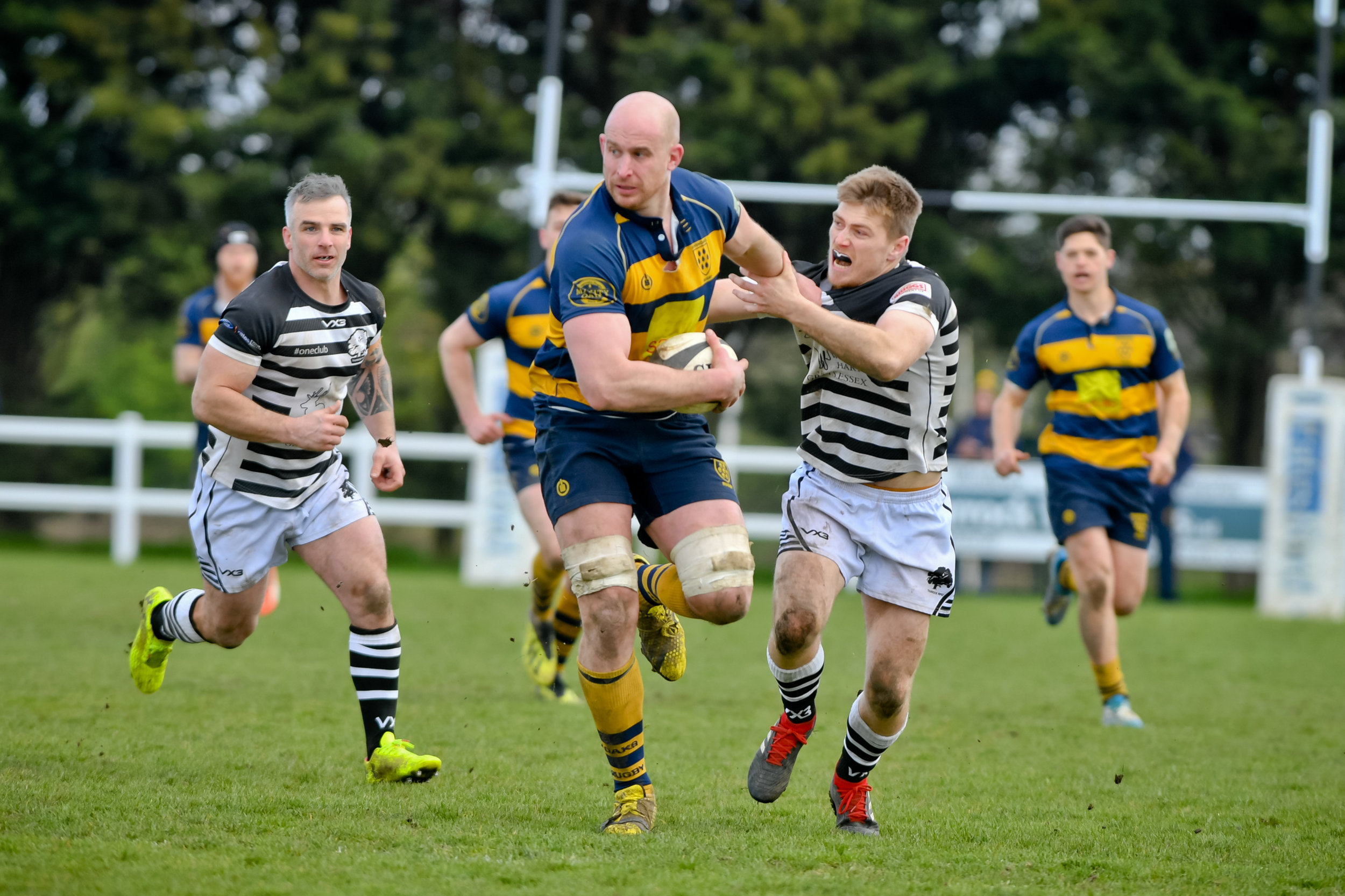 On the charge! Coleman fends off a would-be tackler in his final game as captain. Photo Credit: David Purday