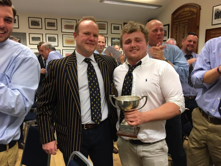 Scotty receives the 16/17 Player of Year Award from President Mike Wooldridge.  Photo Credit: Lee Adamson