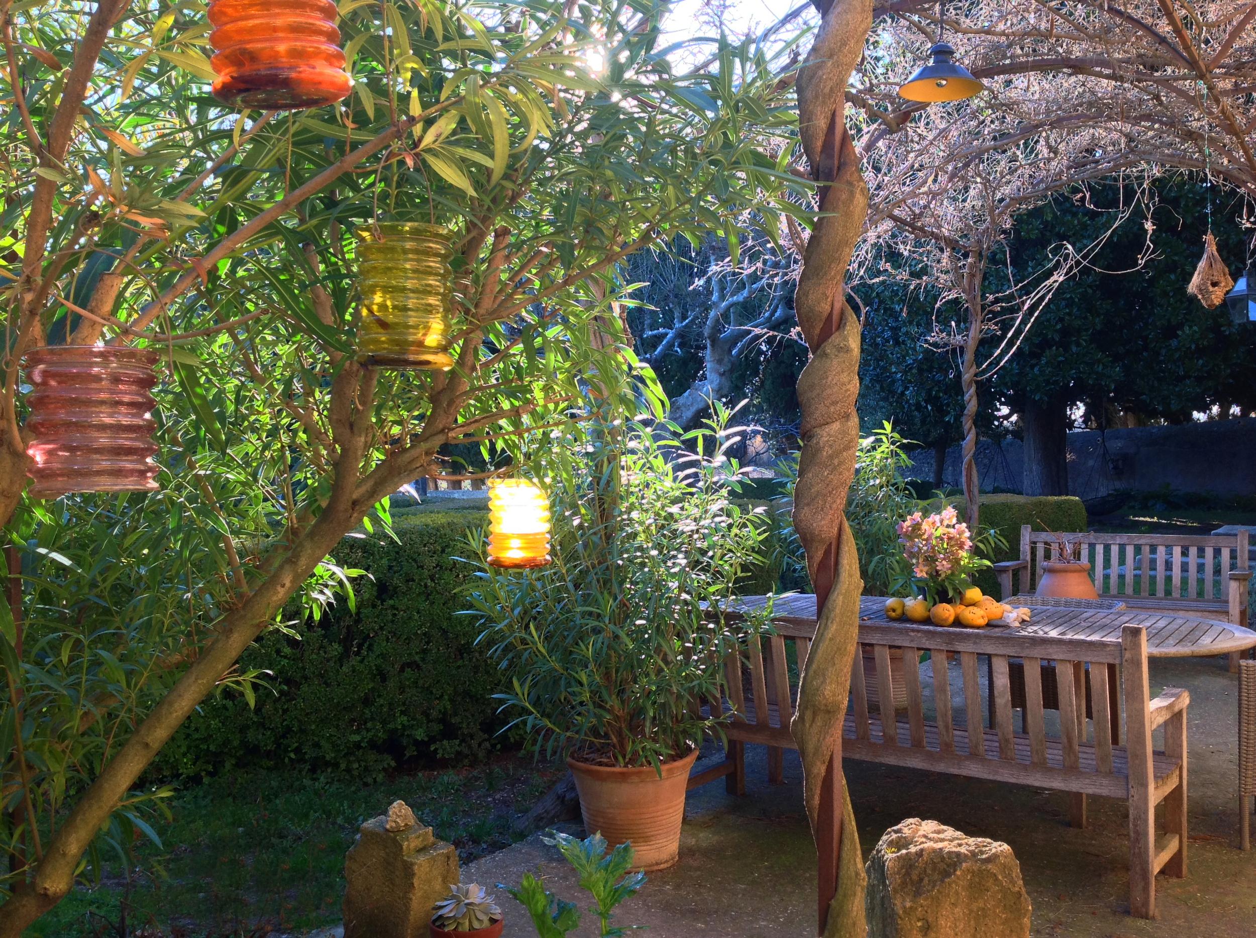 Sunset at Le Pavillon de Galon, the terrace preparing for the blue wisterias...
