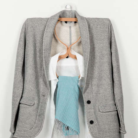 Coat, t-shirt, scarf; a whole outfit embraced by this cleverly structured design.
