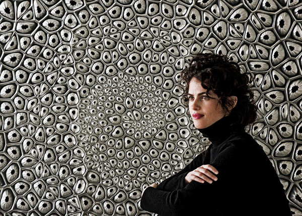 Neri Oxman against the backdrop of her exploration through material ecology.