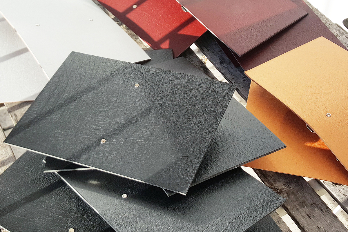 leather Filofax style diary organisers being made in black, gold and red