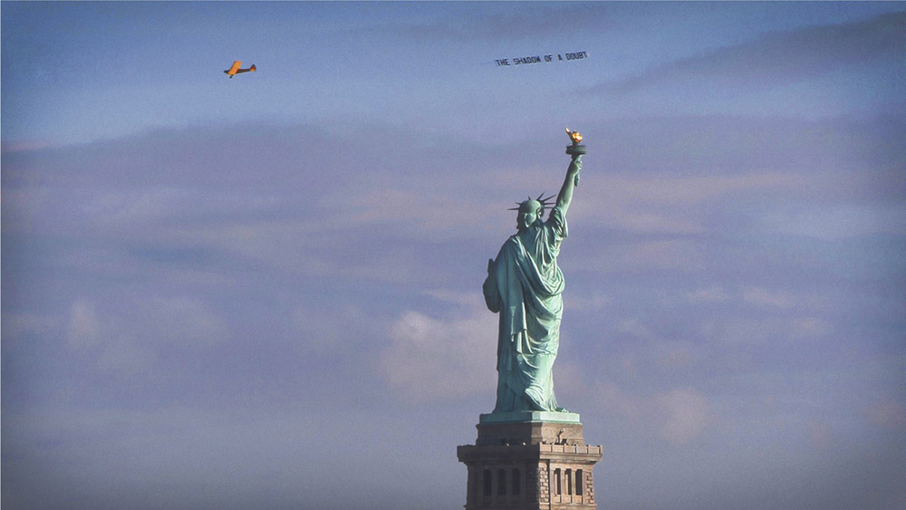 Aircraft banner circling the Statue of Liberty's torch, Veterans Day, 2014
