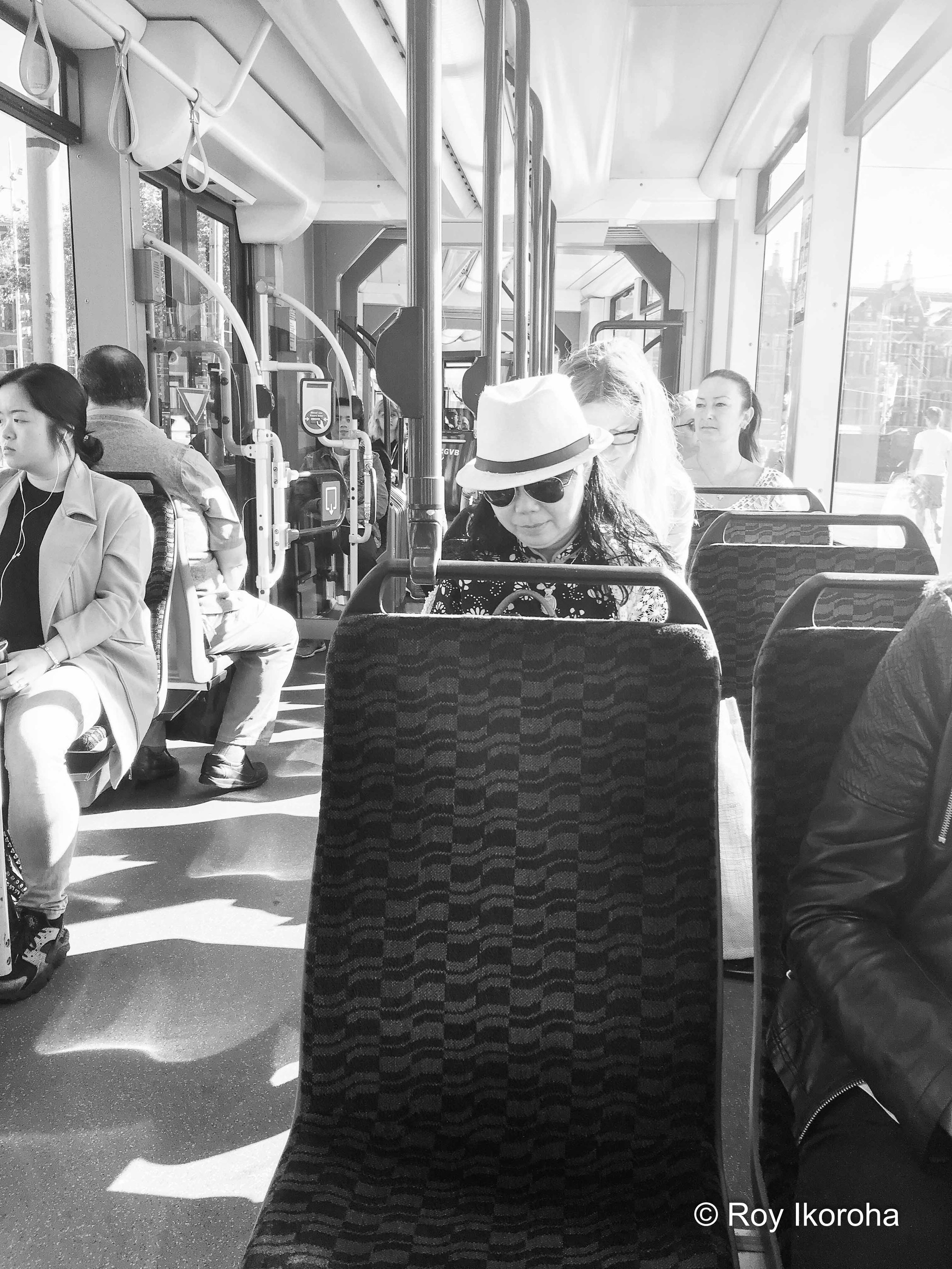 Lady going about her travels via tram, Amsterdam, Netherlands