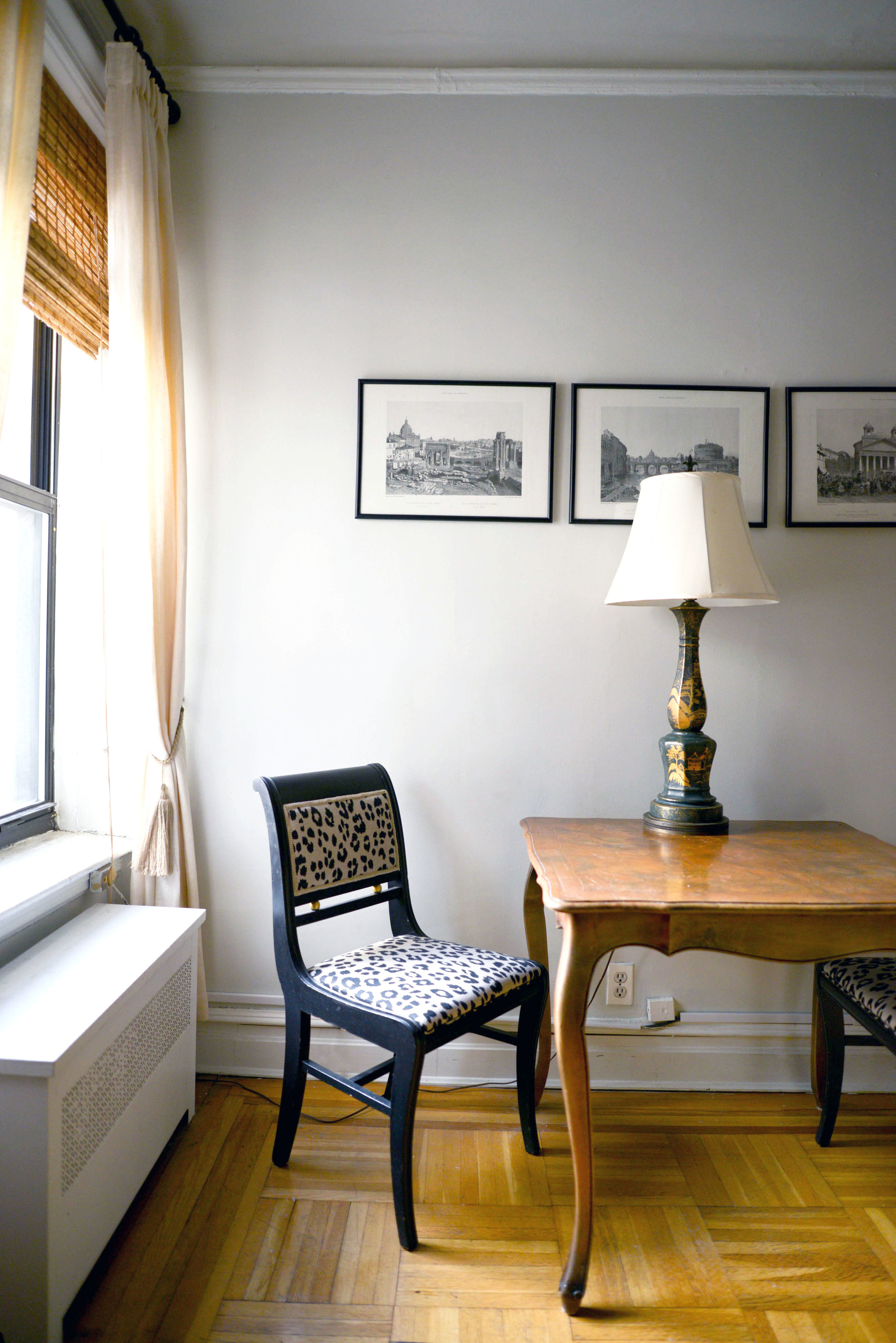 I leave the lamp here on the table because most often it's just me at the apartment. I use this table as a place to work because having my back to the window with the sun shining on it is the best feeling. | Photograph by: Lauren L Caron © 2016