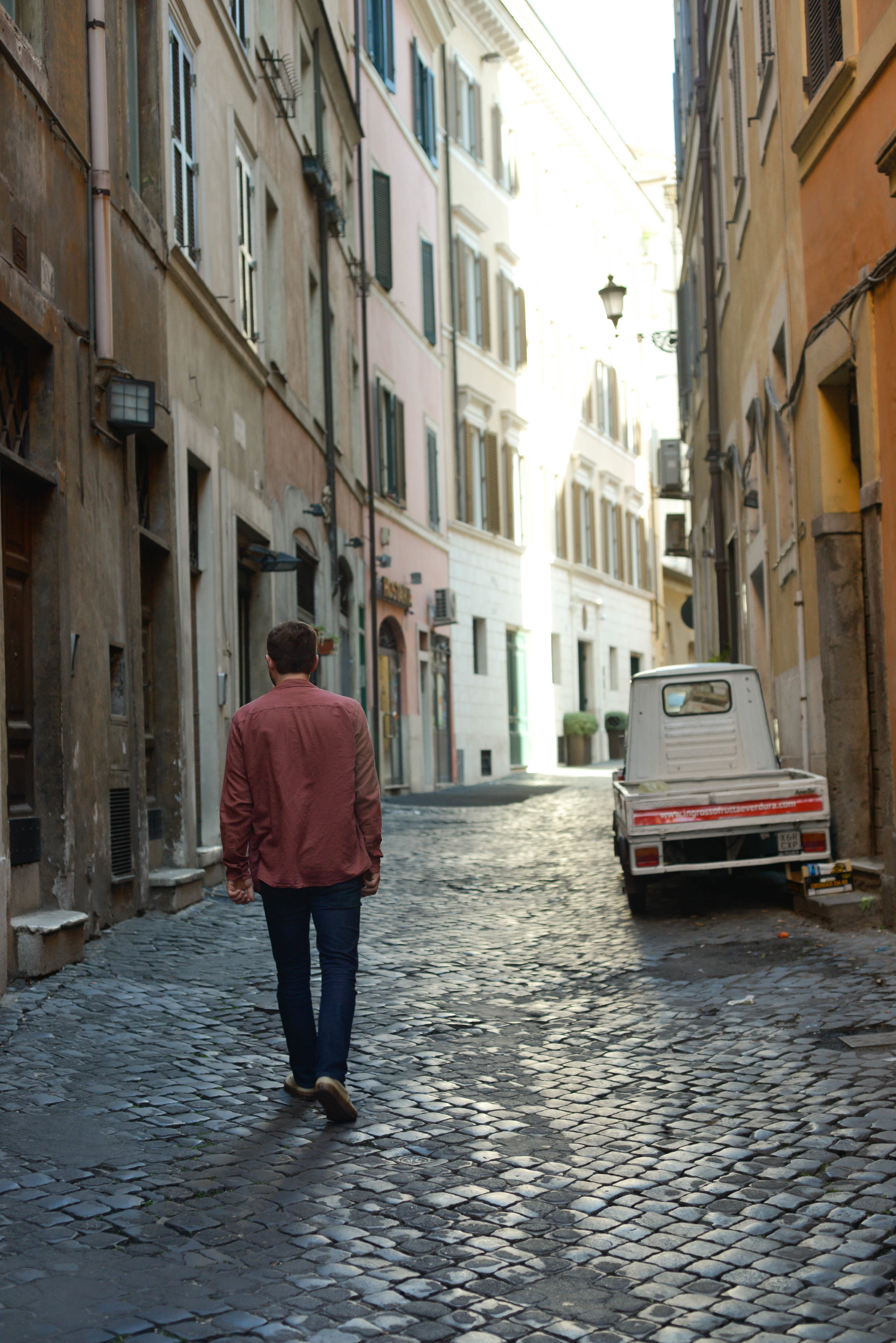 Jack strolling up an empty street on our first day Rome | Photo by Lauren Caron © 2017, A Layered Life Travels.