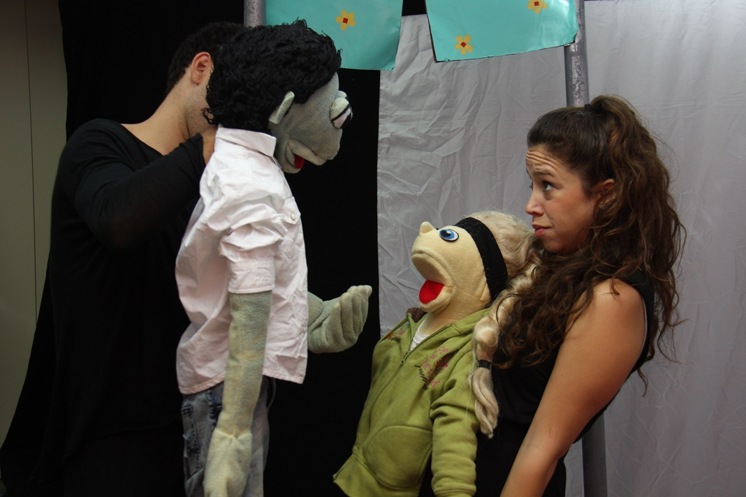 ELI uses puppets to teach schoolchildren about abuse.