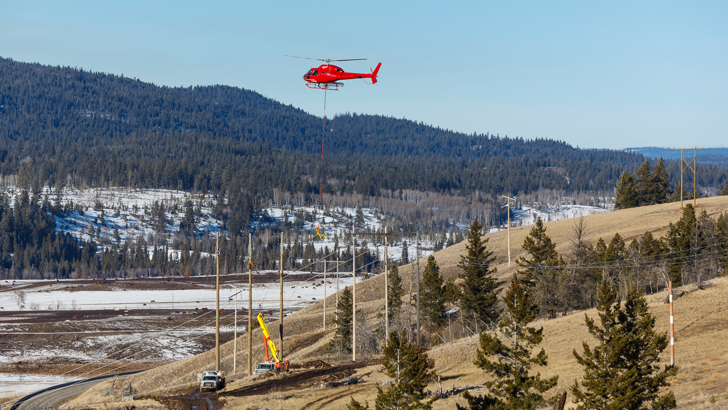 After re-fueling, the helicopter picked up a 'needle' that was needed to thread the line through the middle section of each tower.