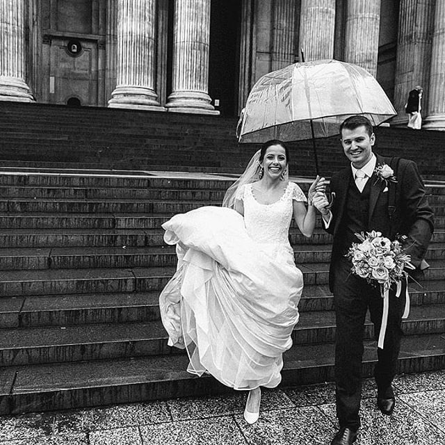 Rain? Ain't no than. Sarah & Callum full of smiles outside the nighty St Paul's Cathedral