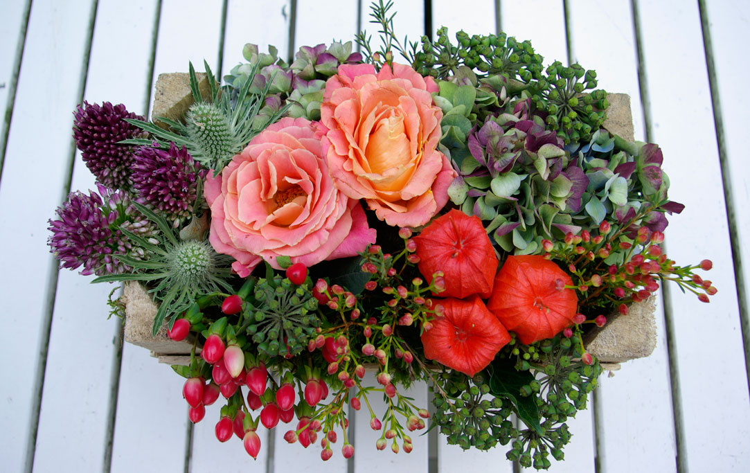 mini crate of autumnal flowers