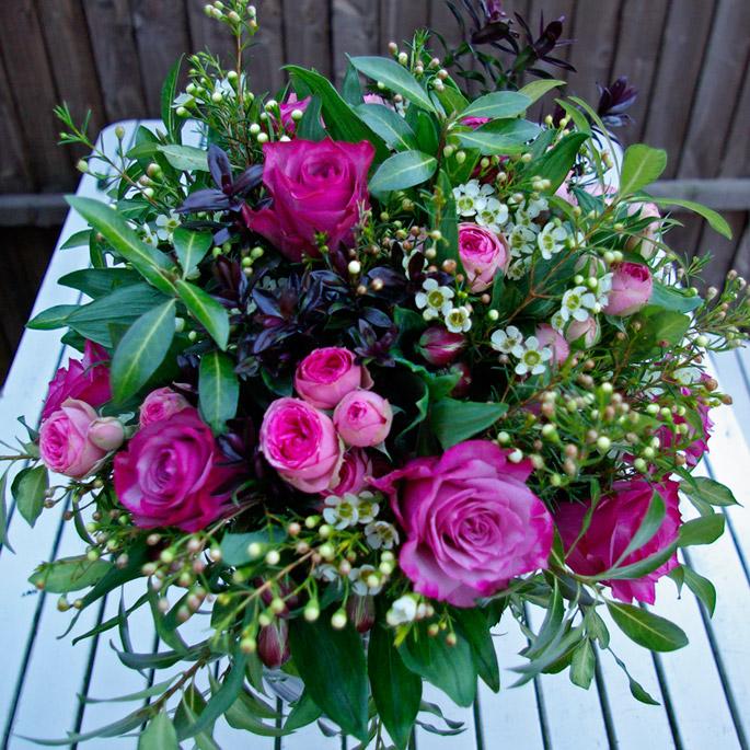 'deep purple' rose, 'super sensation' spray rose, alstromeria, waxflower, hebe, pittosporum