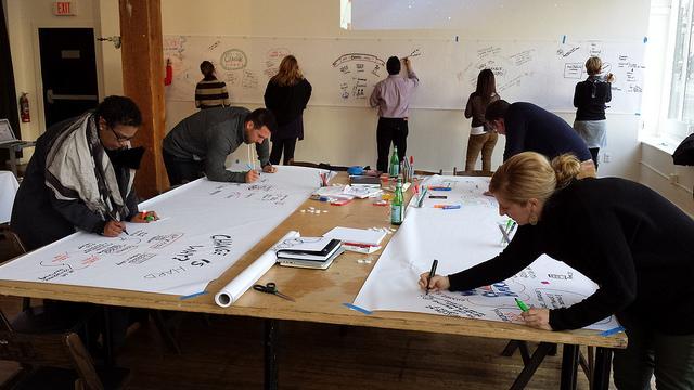 ABOVE: Participants in a Rockstar Scribe Workshop hone their scribing skills.
