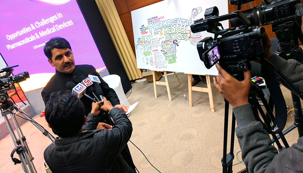 Ministers using our graphic recording as a backdrop for media interviews.
