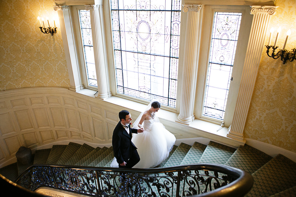 A couple walk up the grand staircase at the Sleepy Hollow country club.