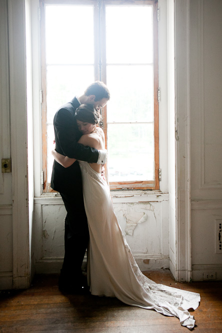 A couple share a warm embrace before their wedding at Alder Manor