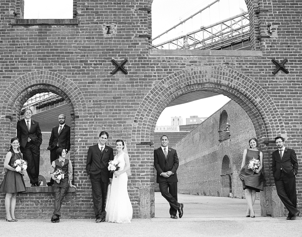 A portrait of the bridal party at the Tobacco Warehouse in Queens.