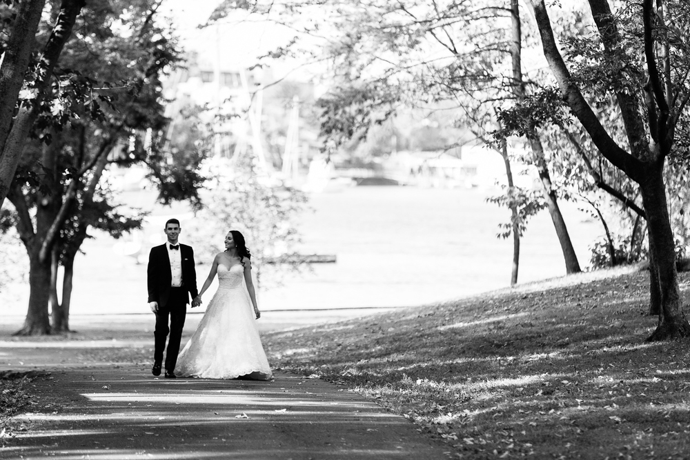 The bride and the groom take a stroll before their wedding at Glen Island Harbour Club.