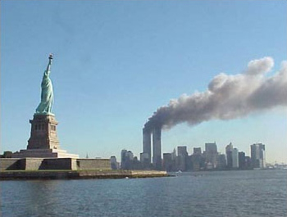National_Park_Service_9-11_Statue_of_Liberty_and_WTC_fire_570x432.jpg