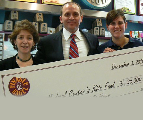 Me with team members at Finagle-a-Bagel in Boston. They raised $25,000 for my nonprofit with coin canisters.
