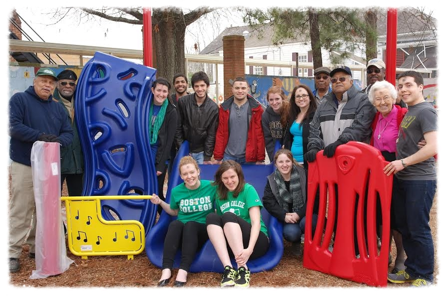 Current Boston College students and staff members of Holy Family get the new playground equipment ready on their service trip this winter.  Holy Family playground fun maintains Hughes' legacy going