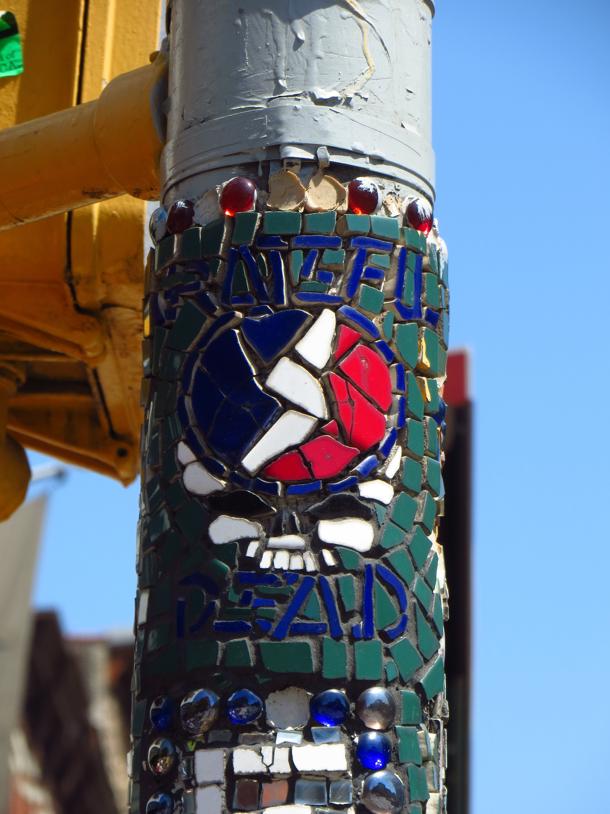 Mosaic signpost by former sight of Fillmore East concert hall