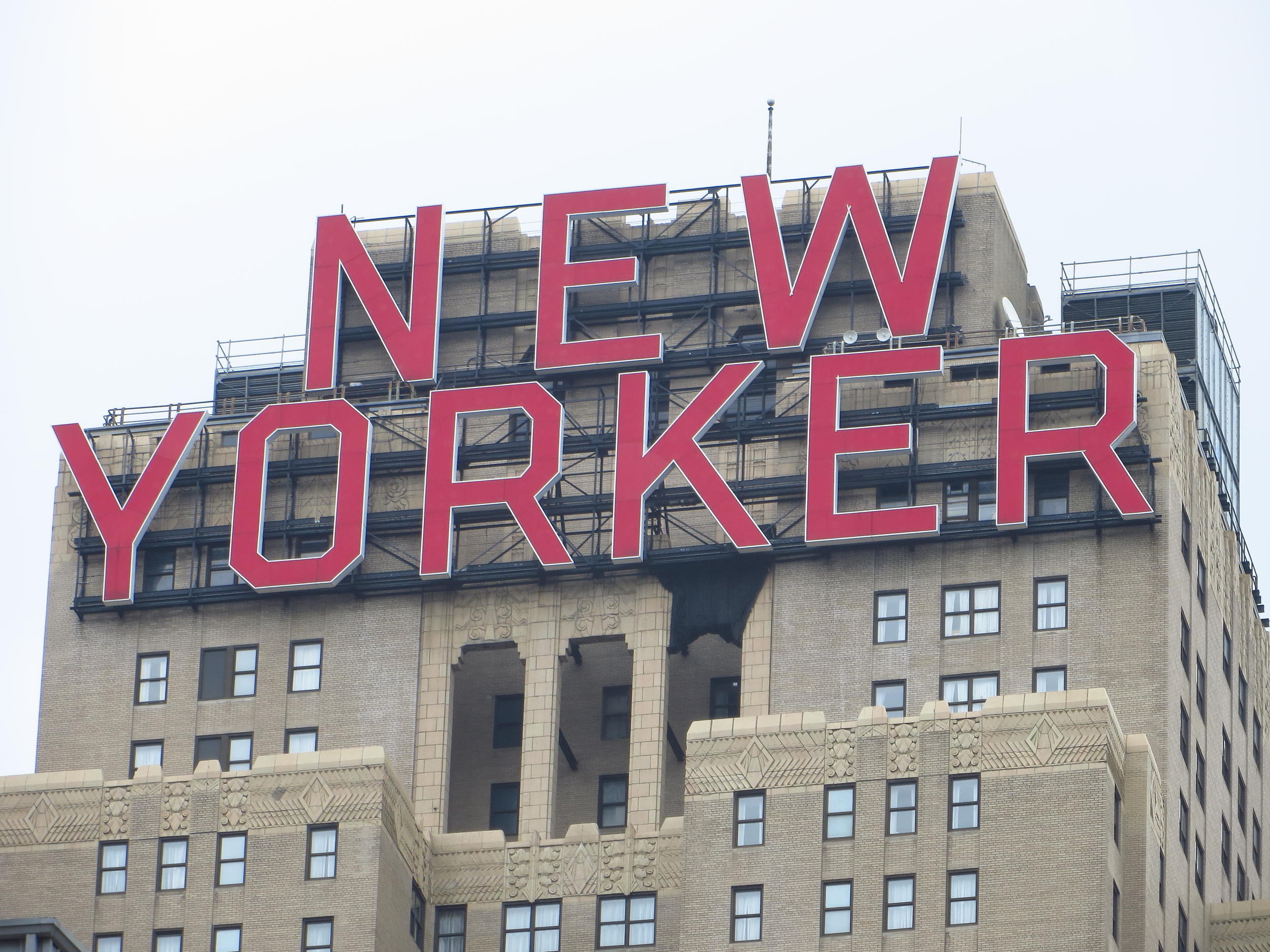 New Yorker Hotel sign