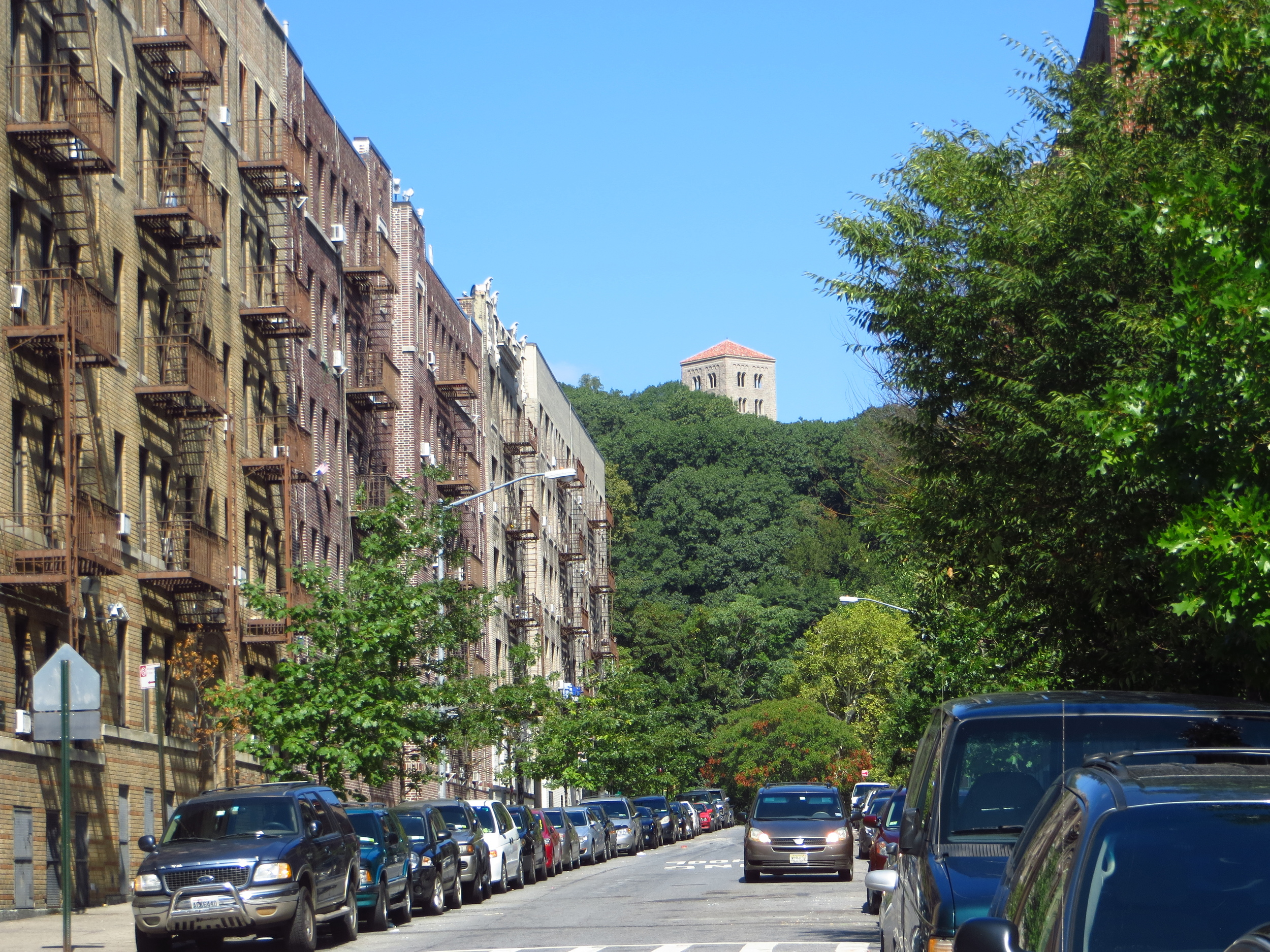 Typical Inwood street with Cloisters in the background