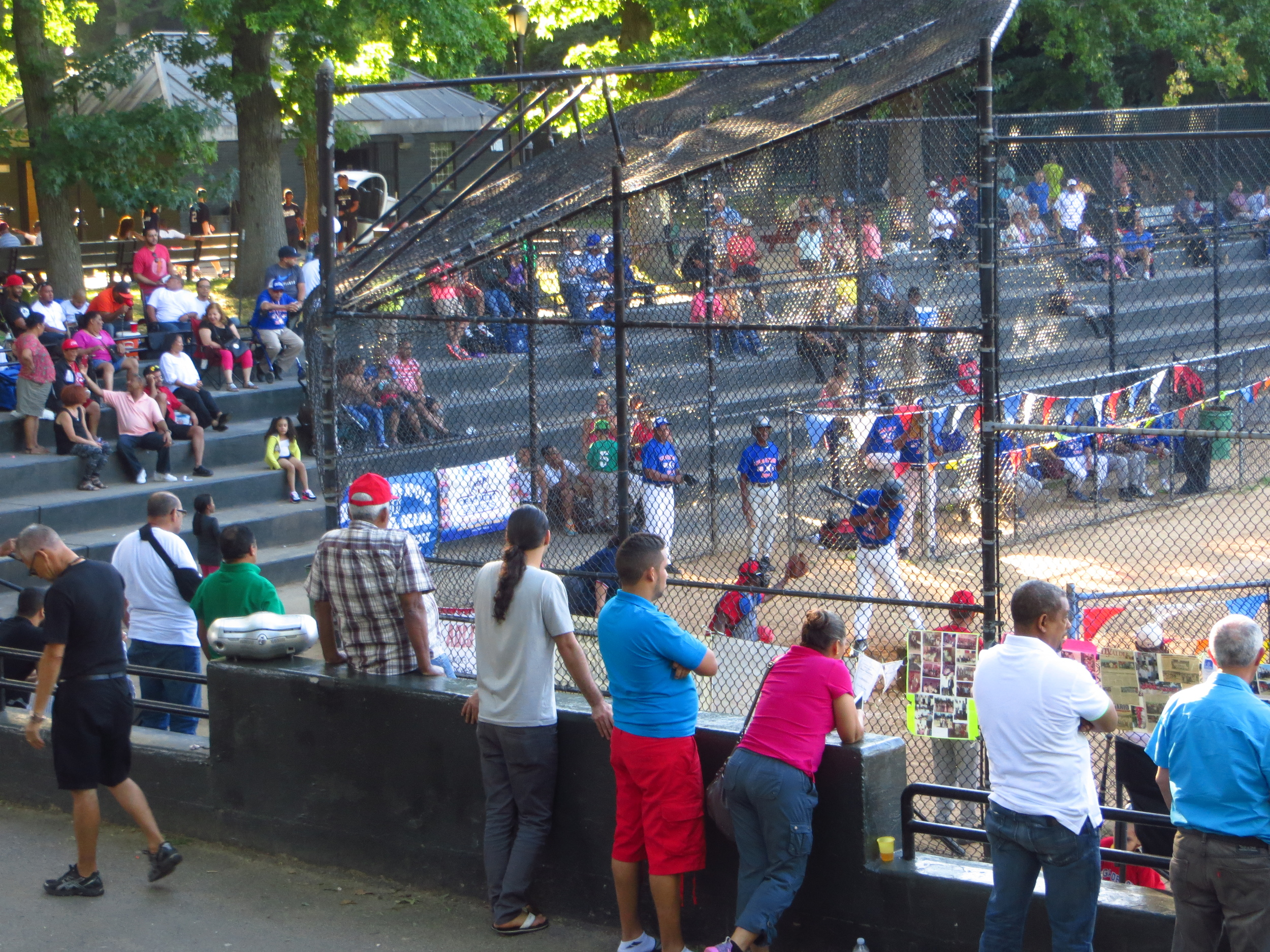 Well attended baseball game in Inwood Hill Park