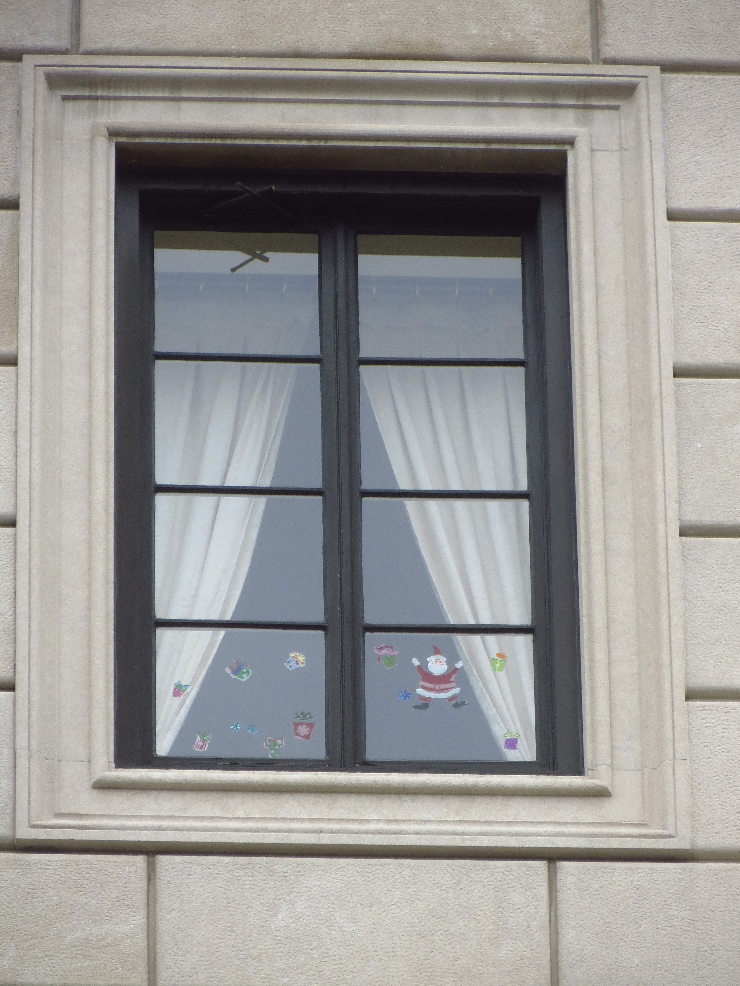 Holiday stickers in the 4th story windows of the French Consulate