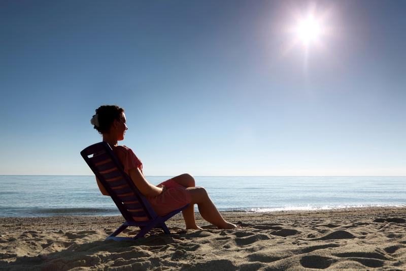 dreamstime_s_17215615_woman beach sitting sun.jpg