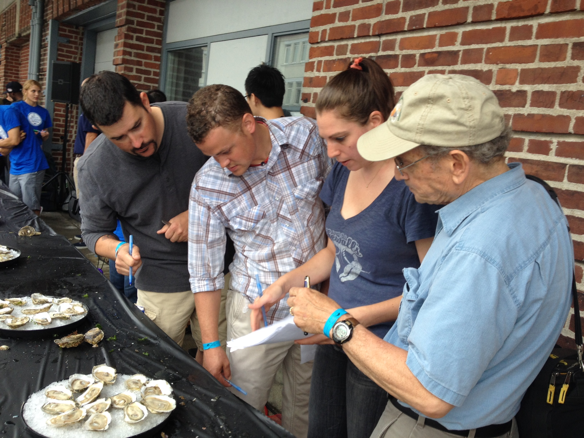 Judges taking a good look at the competition oysters. From left: Dan Enos (Oceanaire), Stephen Oxaal (B&G Oysters), Nicki Hobson (Island Creek Oyster Bar), and Richard Rush (Oyster Information).