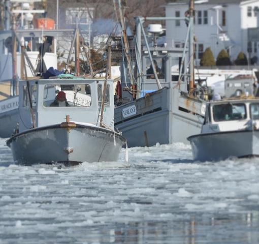 norm bloom's fleet breaking through an iced over harbor
