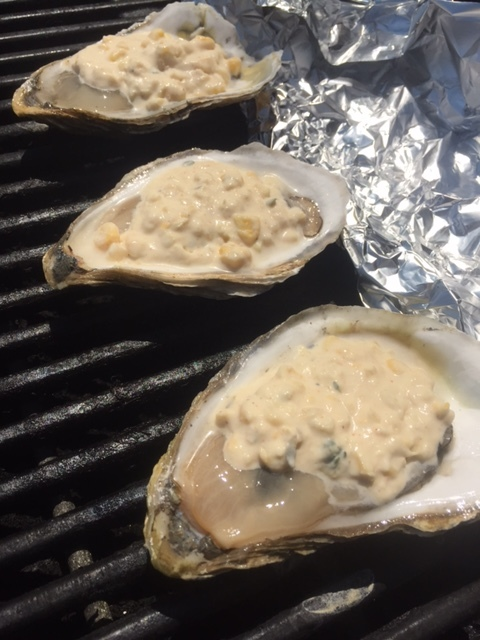 Support the bill of the oysters with a row of foil to prevent any spillage