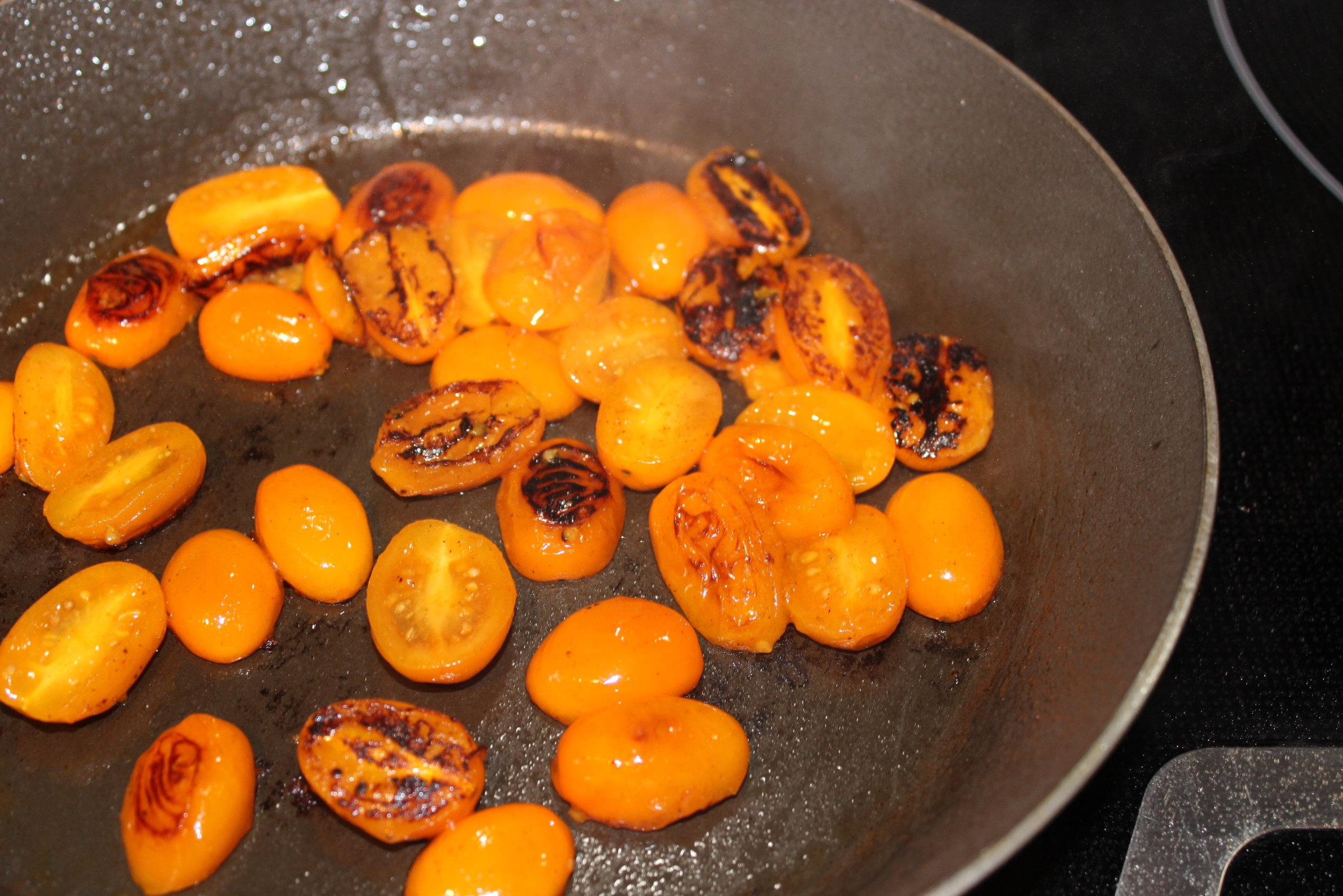 Blistered tomatoes give a MELLOWED acidity to the dish