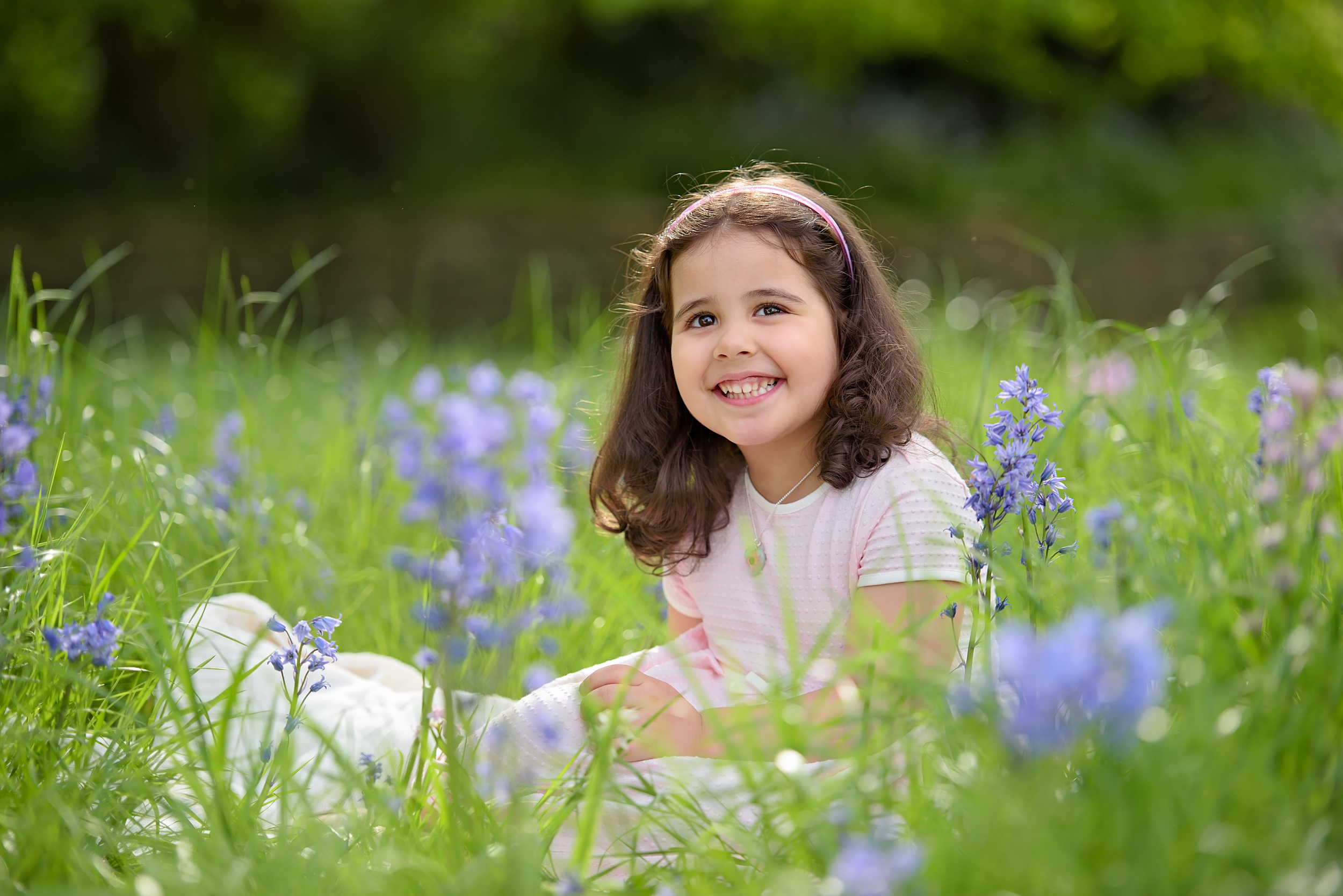 Child portraits in bluebells, London