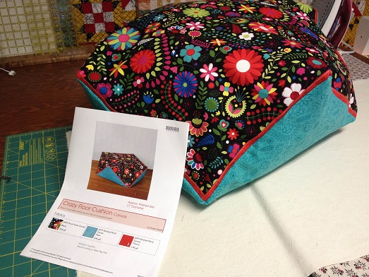 Easy to make Crazy Floor Cushion by Connecting Threads.  Bright colors too!