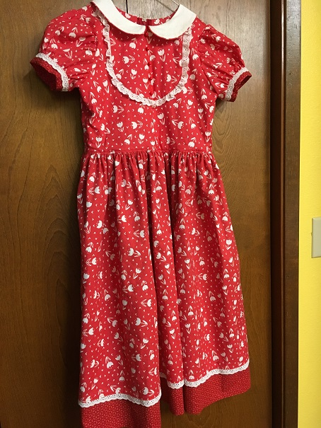 This dress is a size 8, for a 9-yr-old.  The Sweet Dress with modifications and custom embellishments.  More later...