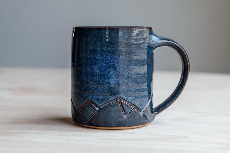 "Mountain Mug - Seaside   $16.50 Wholesale   $28 MSRP  Approx. 3.75"" tall x 3.25"" wide, 12 oz"