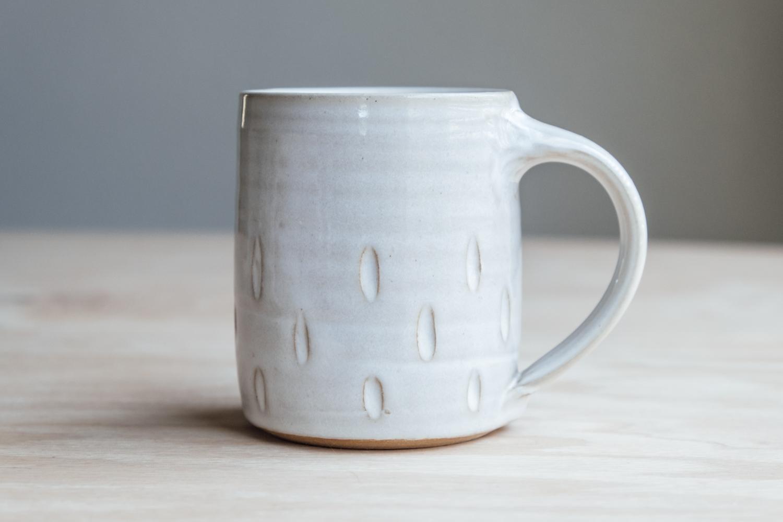 "Teardrop Mug - Eggshell   $16.50 Wholesale   $28 MSRP  Approx. 3.75"" tall x 3.25"" wide, 12 oz"