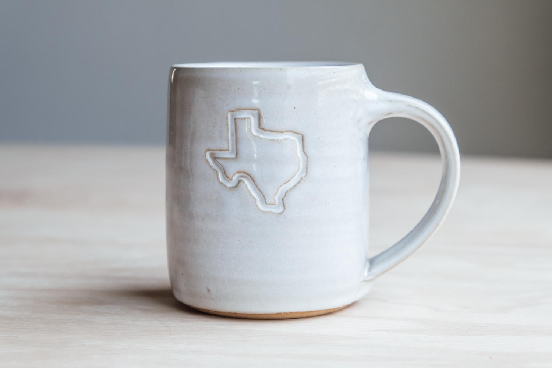 "Texas Mug - Eggshell   $16.50 Wholesale   $28 MSRP  Approx. 3.75"" tall x 3.25"" wide, 12 oz"