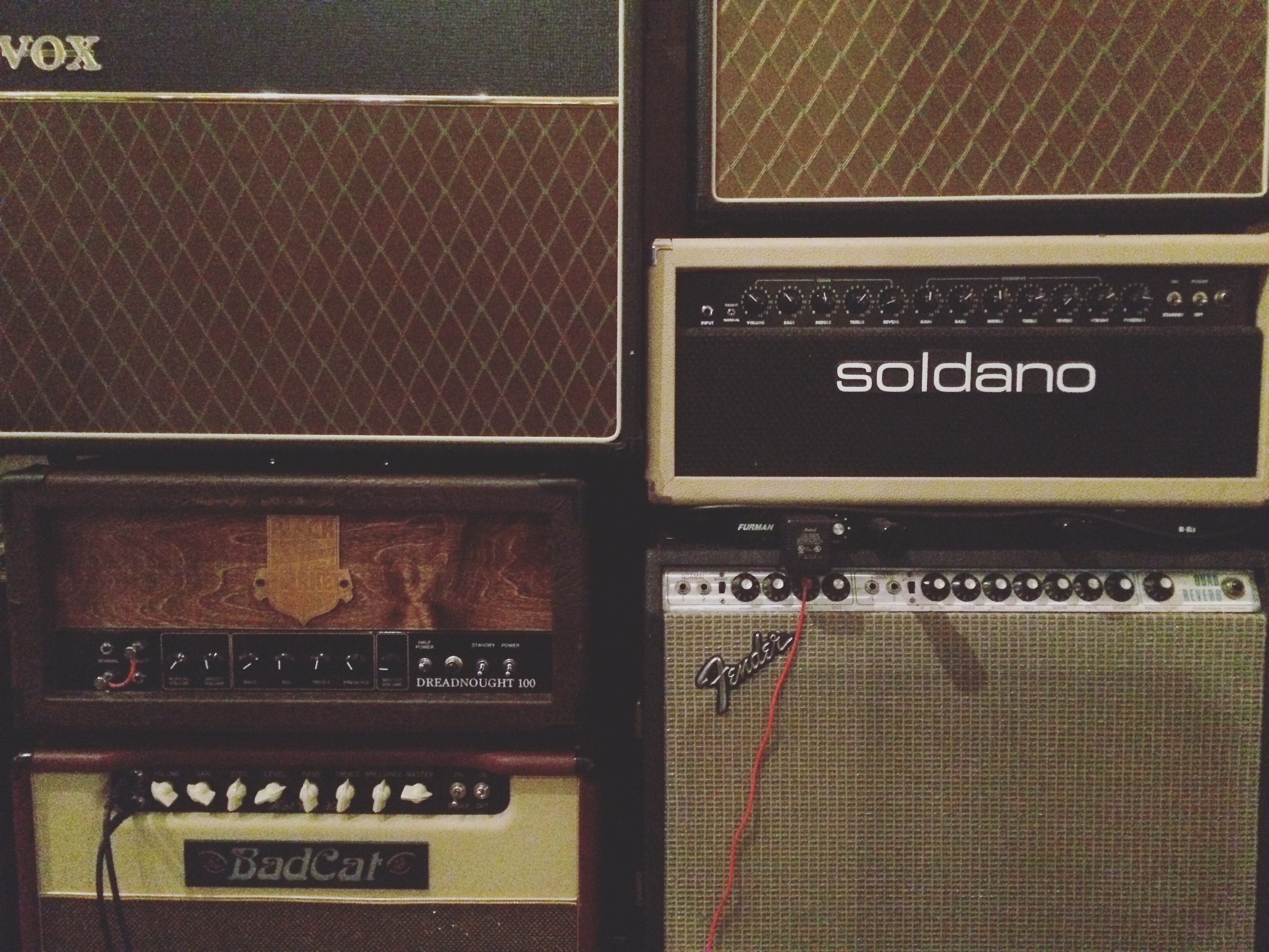 The wall of amps. I wish I took more photos during recording, but we did the entire record in two weeks and it never crossed my mind. I slept on the control room floor most of the time!