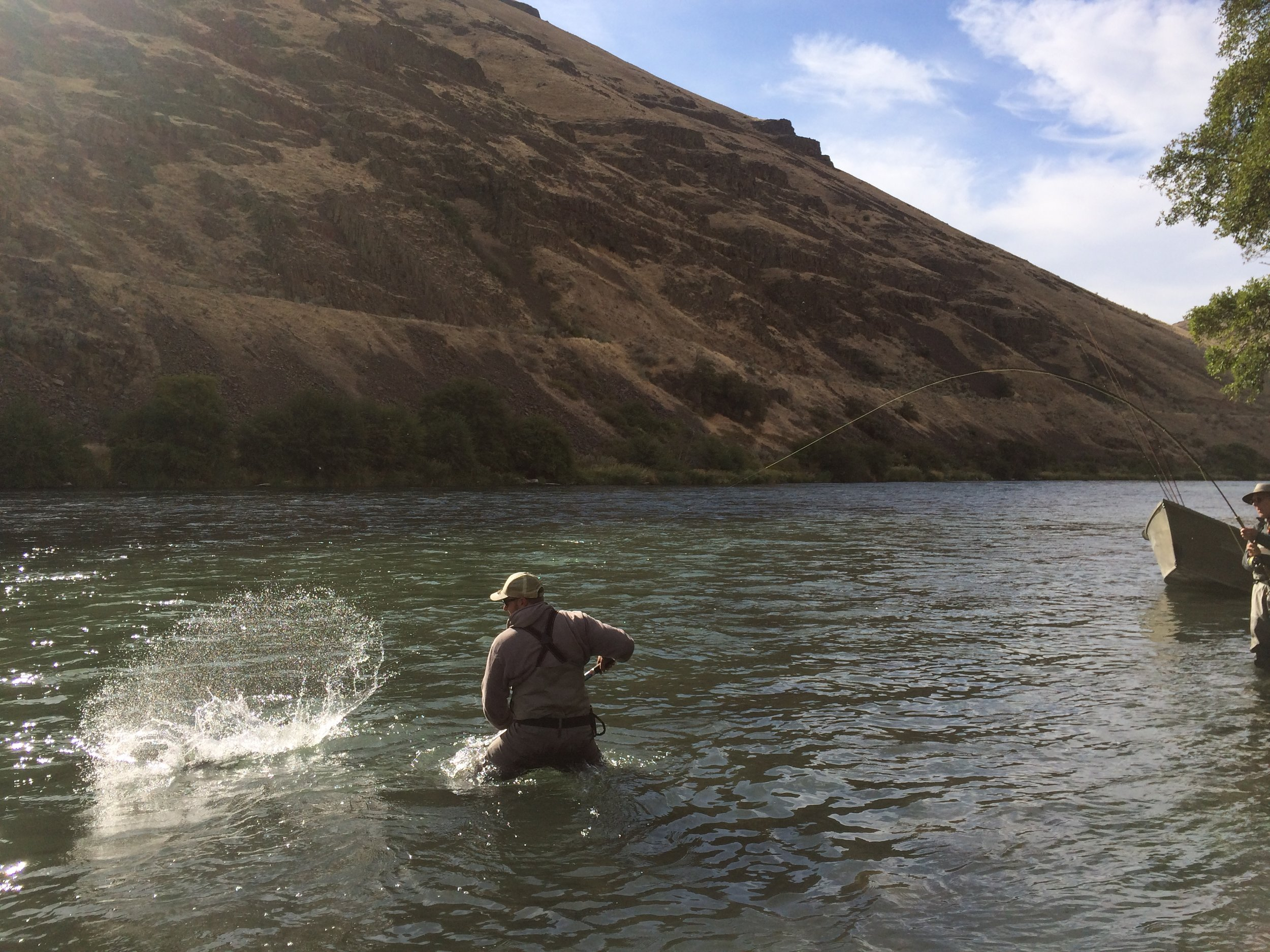 Nick Rowell helping Jum DeLacy close the deal on his first dry fly steelhead.