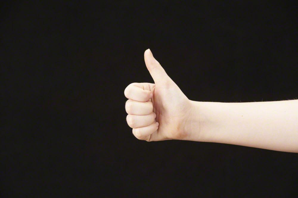 Thumb up - girls hand