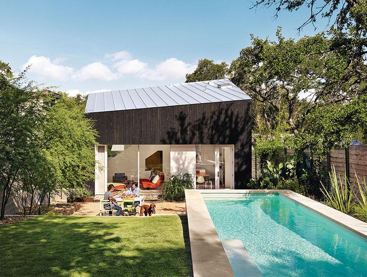 texas_hold_em-renovation-addition-facade-outdoor-pool-cypress-paneling-metal-room.jpg