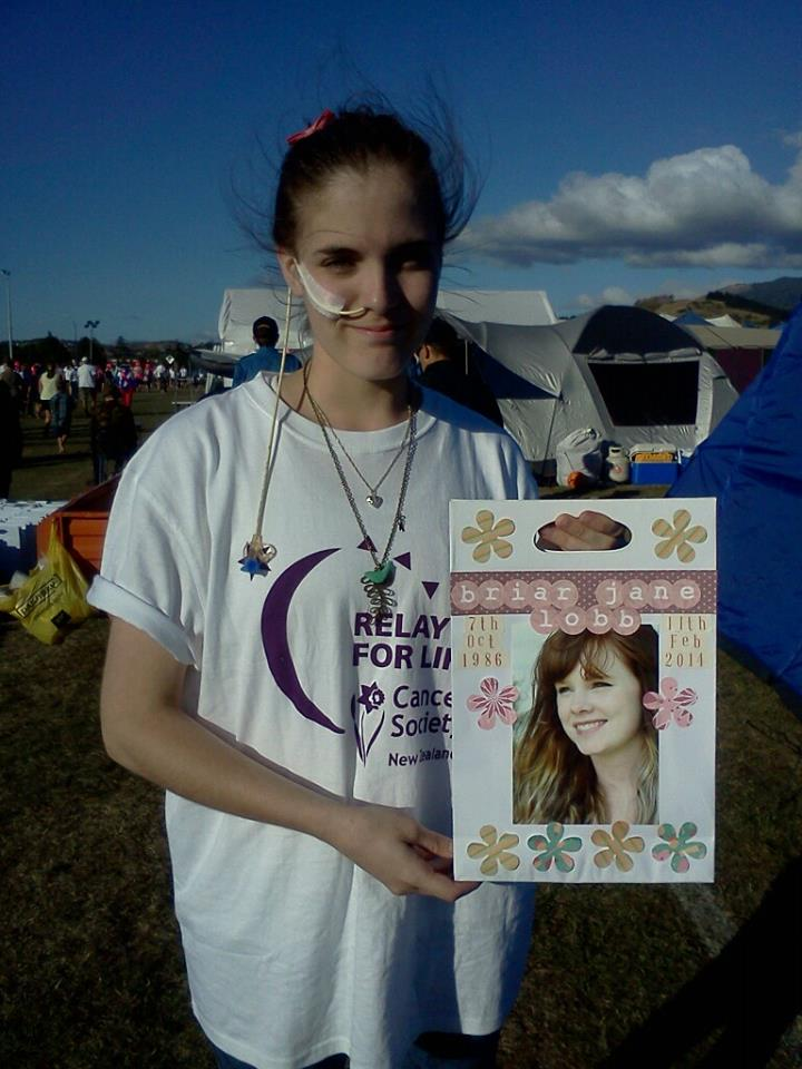 Georgia Ferris holding the candle bag she made for Briar at this years Relay for Life Nelson.