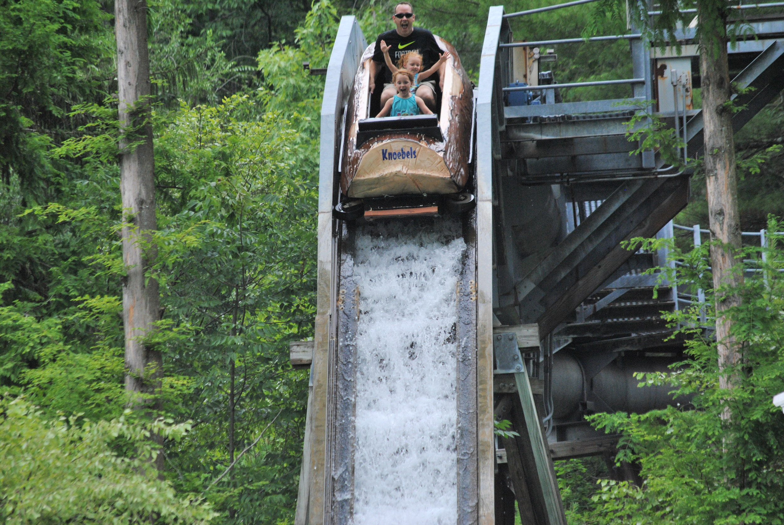 Tom, husband of Katie Bonner (Purchasing), and their daughters Quinn and Kailin enjoying their first ride on the Log Flume at Knoebels Grove.