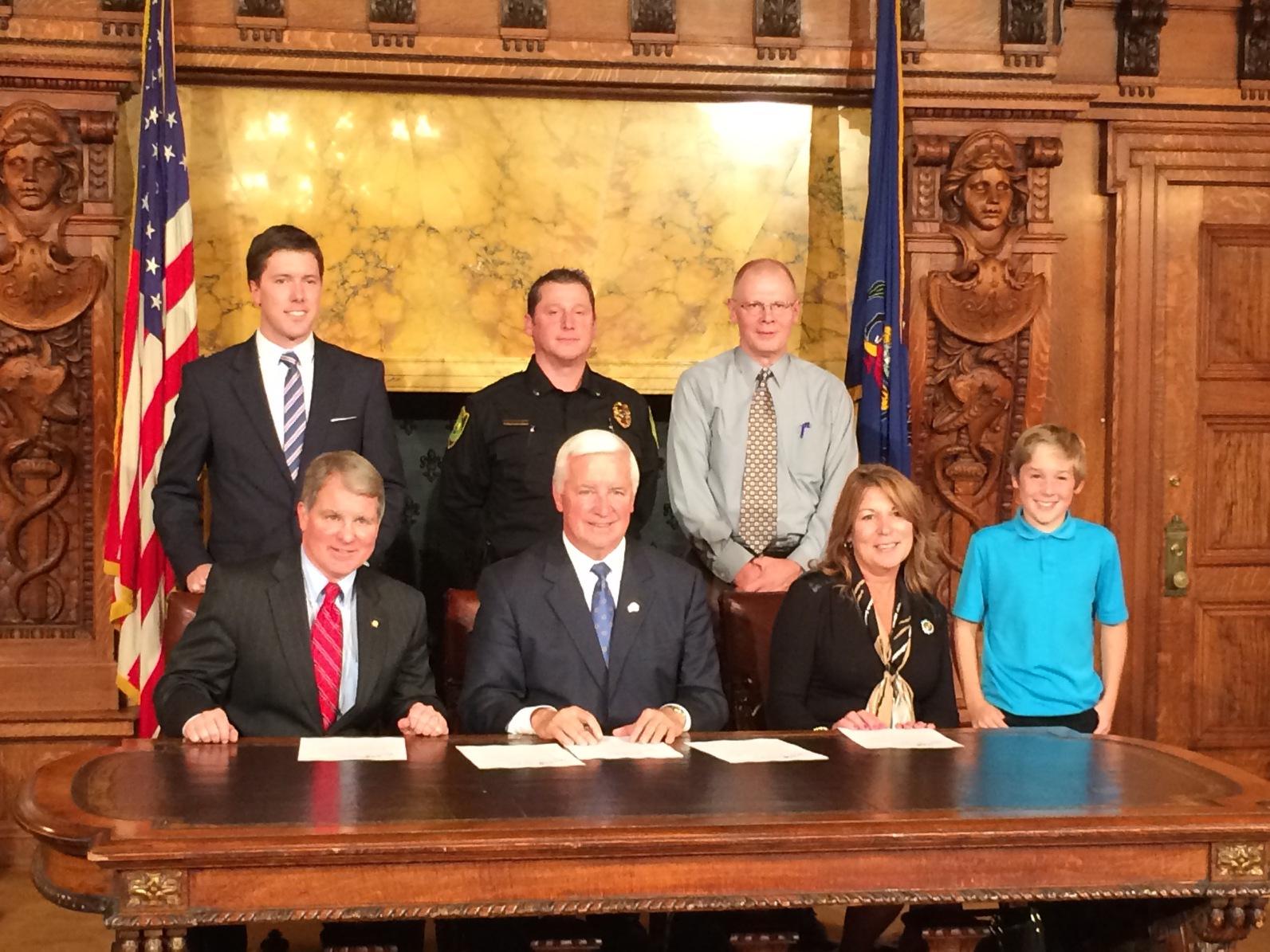 Standing from left to right is Jon Hopcraft. Lt. Matthew Johnson, David Johnson, Adyson Johnson  Sitting from left to right is Senator David Argall, Governor Tom Corbett, Representative Tina Davis.