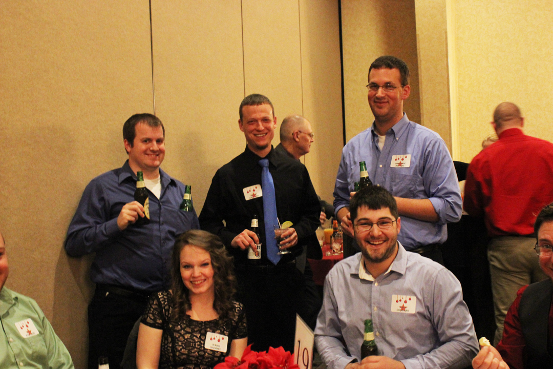 Left to Right back row: John Smolczynski, Ryan Bausher, Nate Mengel, Left to right front row: Kara Kunkel and Kyle Sanders enjoying the cocktail hour before the holiday dinner