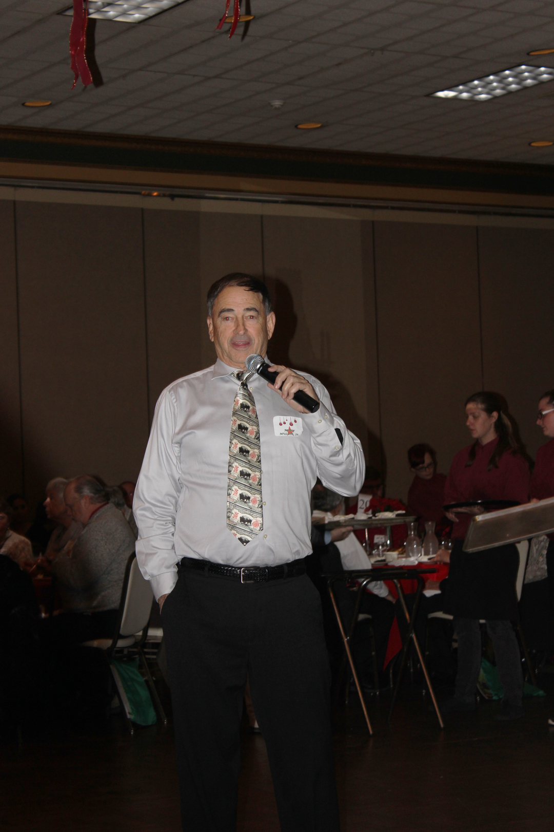 Andrew Muller Jr, RBMN CEO and Owner, addressing the employees at the holiday party